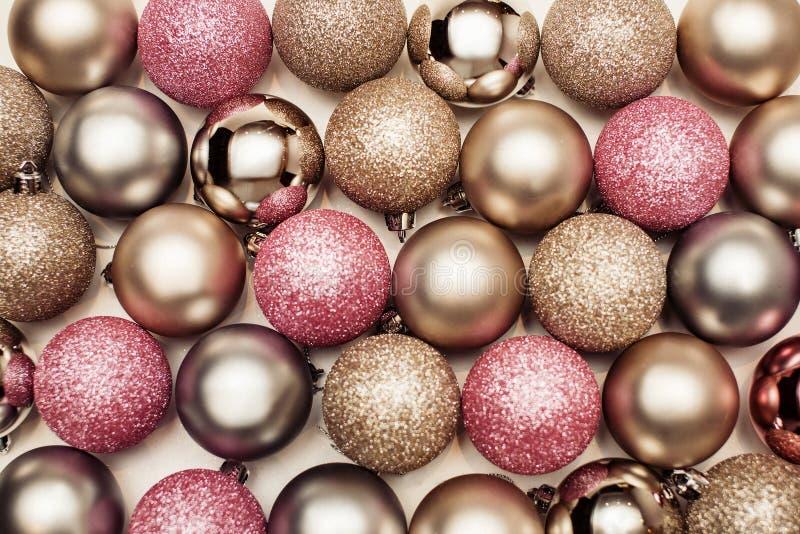Christmas balls background, happy new year. Christmas balls background pink and gold, happy new year stock photo