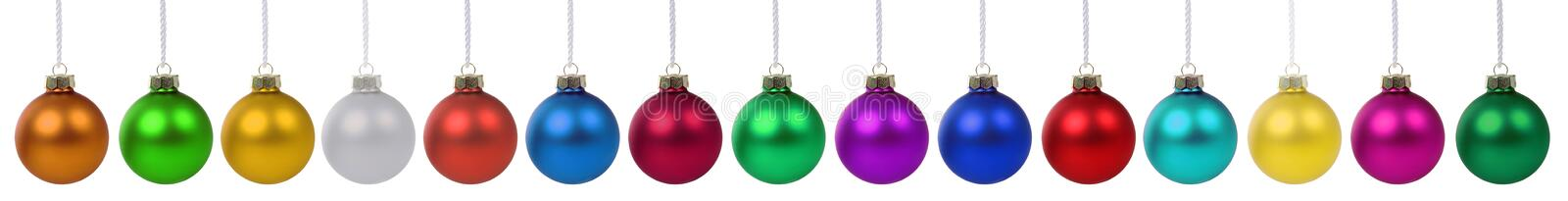 Christmas balls baubles banner colors colorful decoration in a r. Ow isolated on a white background royalty free stock photography
