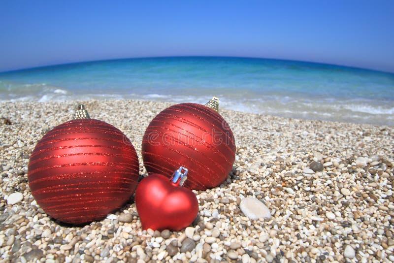 Christmas balls on the beach stock photo