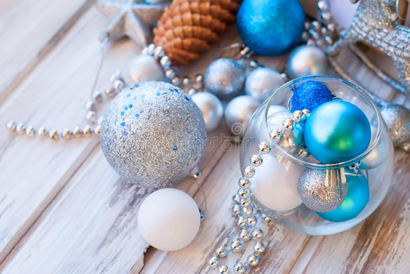 Christmas balls, beads, cones, Christmas background. Christmas background. Merry Christmas branches,gift box, balls, ribbon, cones, Blue and white color stock image