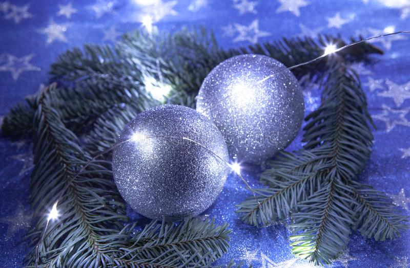 Christmas balls on blue background, night illumination concept, top view royalty free stock photography