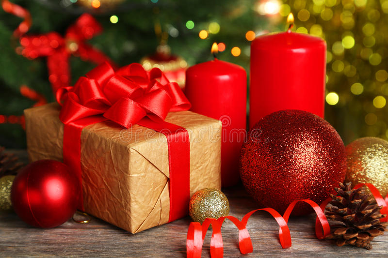 Christmas balls and candles on wooden background royalty free stock photo