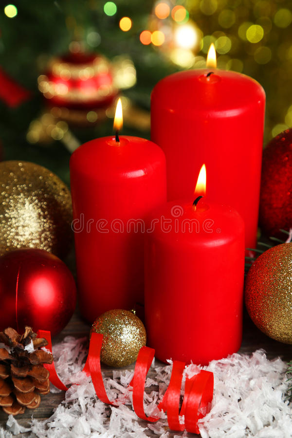 Christmas balls and candles on wooden background royalty free stock photography