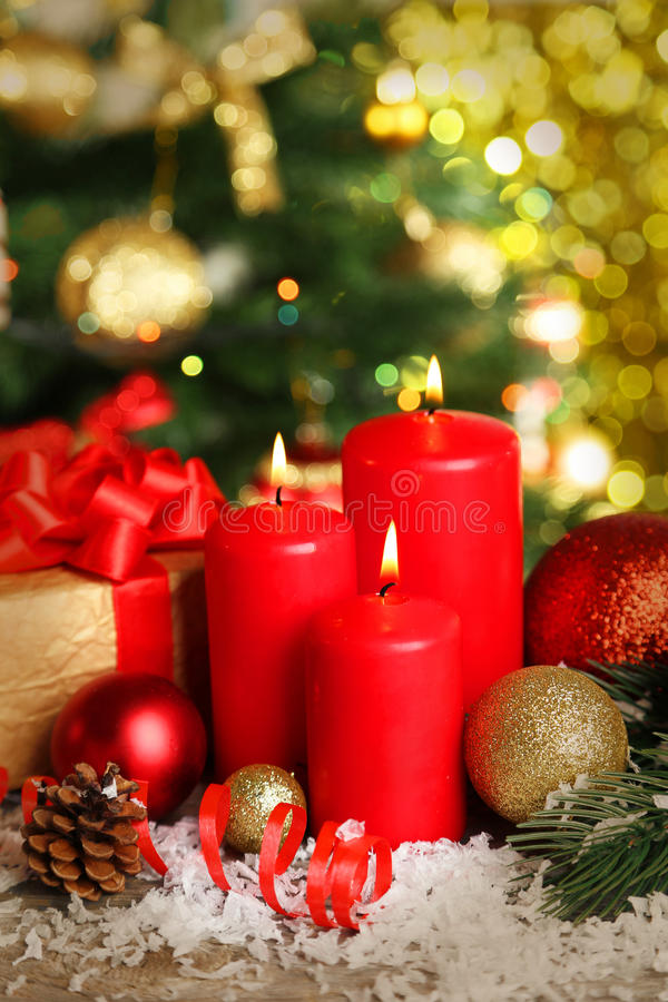 Christmas balls and candles on wooden background stock photography
