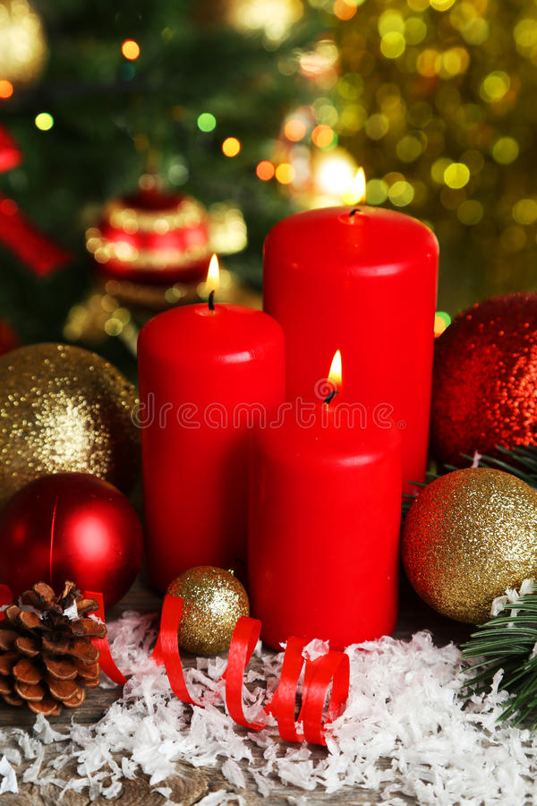 Christmas balls and candles on wooden background stock photo