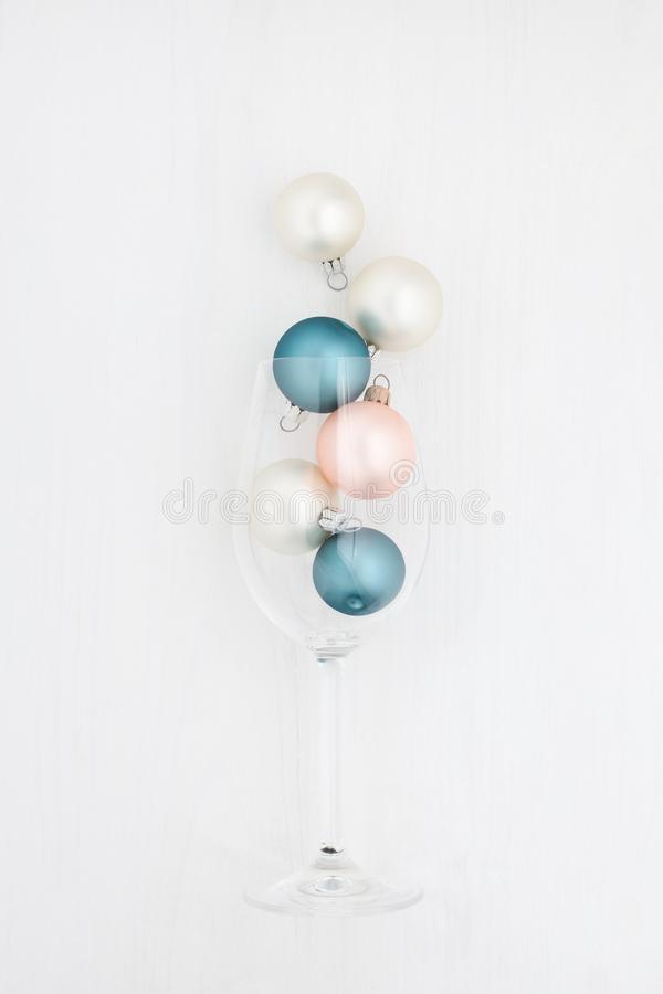 Christmas balls in a champagne glass on a white background stock image