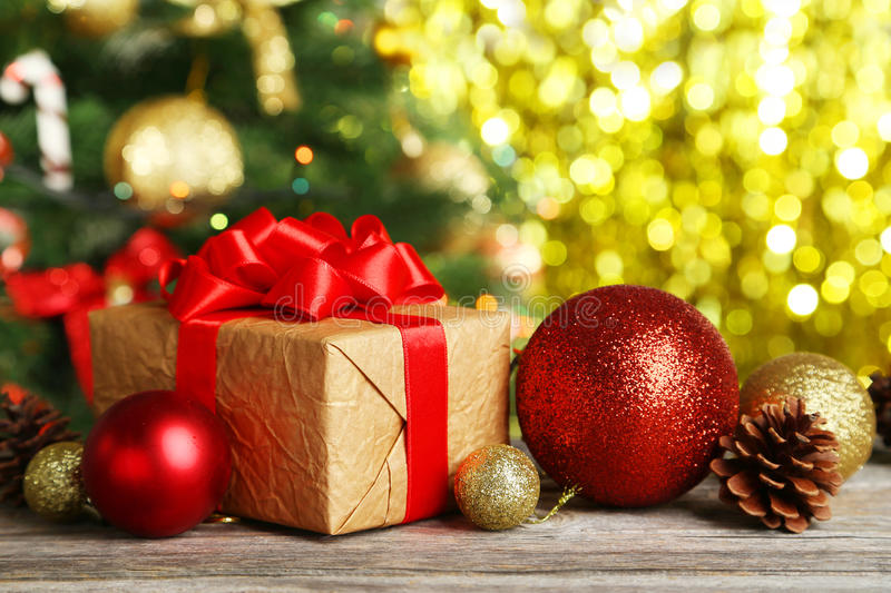 Christmas balls and Christmas gift on wooden background stock photo
