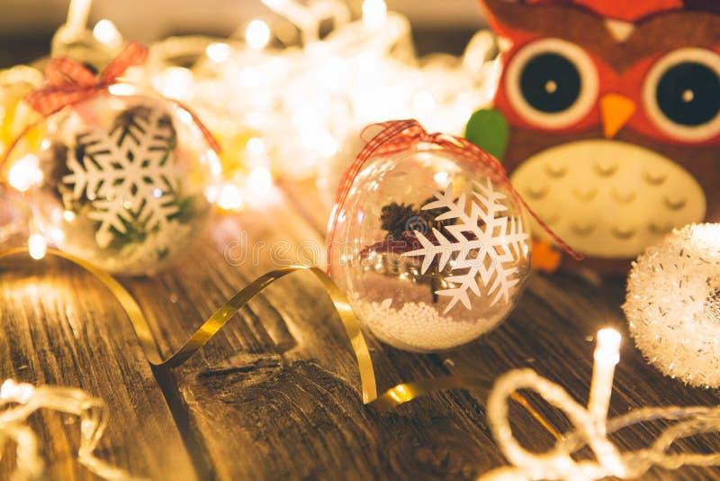 Christmas balls and christmas lights on a wooden surface.  stock image