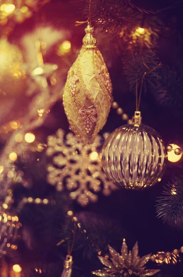 Christmas balls on the Christmas tree. Christmas decorations on the Christmas tree, snowflakes, balls, garlands, closeup, texture, background stock image