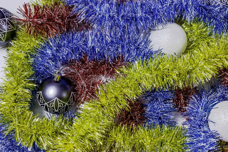 Christmas balls and colored tinsel royalty free stock photography