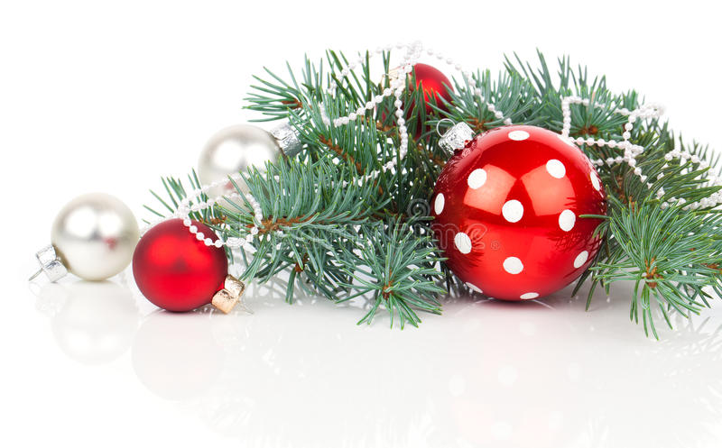 Christmas balls and fir branches. With decorations over white stock image