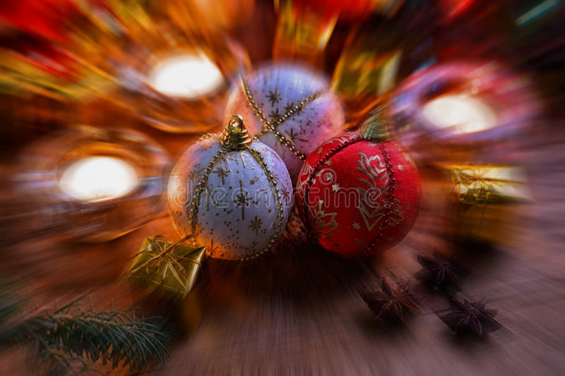 Christmas balls, gift boxes, anise and candles. Blurred stock photo