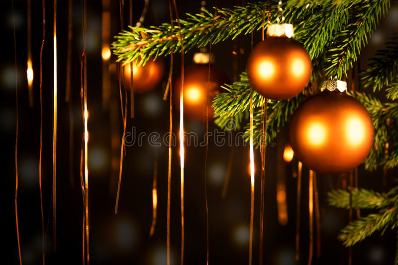 Christmas balls with golden lights stock images