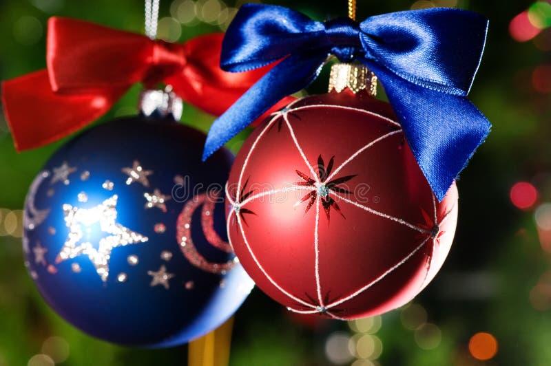 Christmas balls on green background stock image