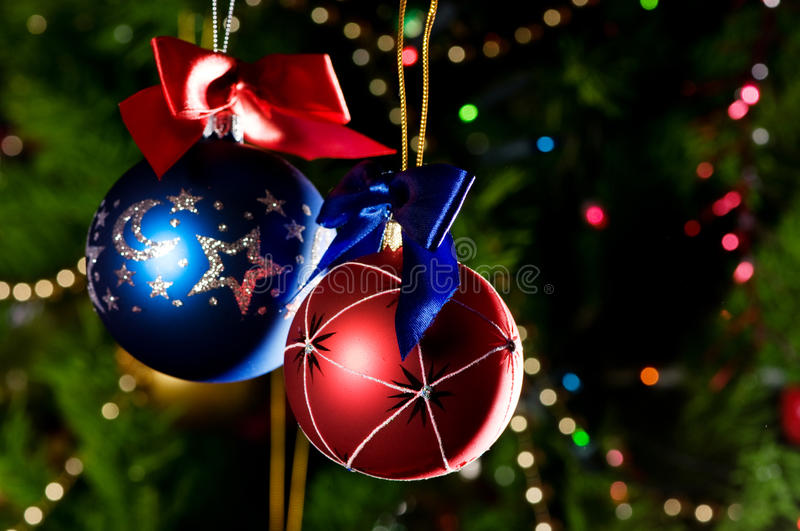 Christmas balls on green background stock photography