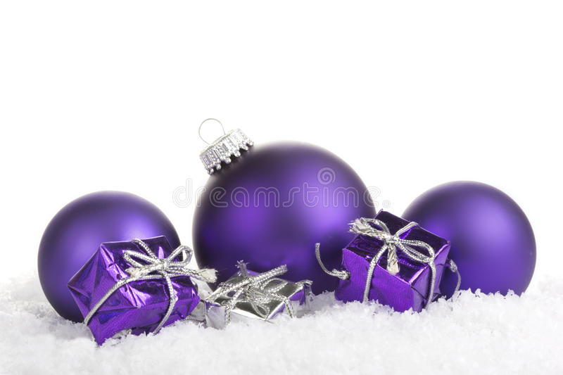 Christmas balls. Purple with presents on white background royalty free stock image