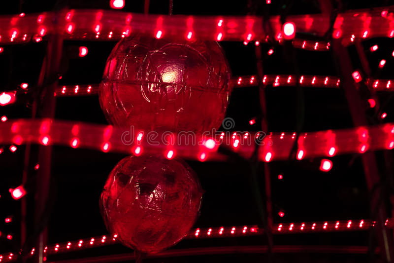 Christmas balls in a scarlet light royalty free stock photos