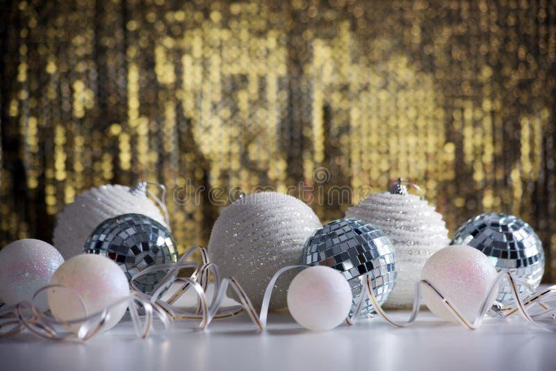 Christmas balls on shiny backgroun. Christmas balls on shiny golden backgroun royalty free stock photography
