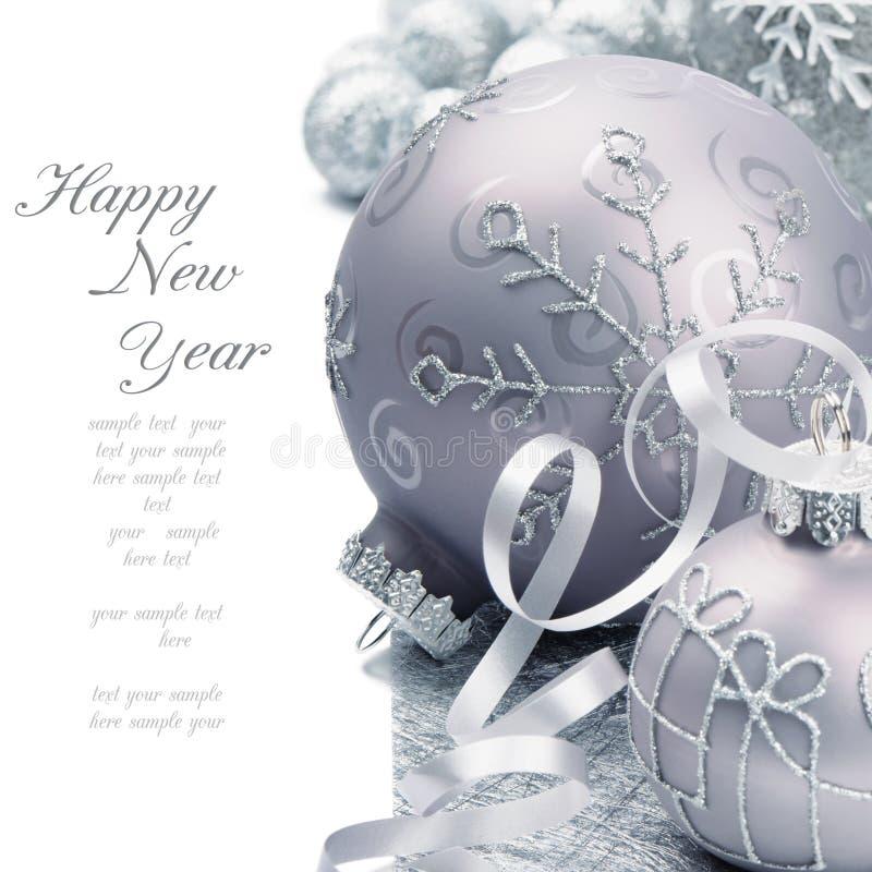 Christmas balls on silver background stock photos
