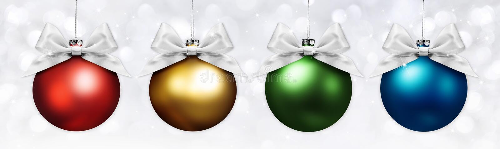 Christmas balls with silver ribbon bow on blurred lights royalty free stock images