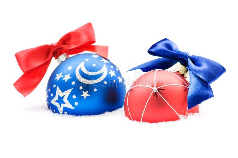 Christmas balls in snow stock photo