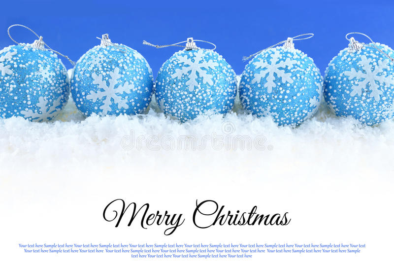 Christmas balls on the snow stock photos