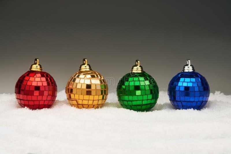 Christmas balls in snow stock photos