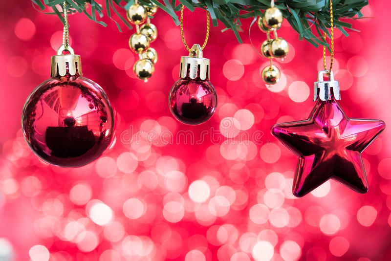 Christmas balls and star ornament decorate on fir tree with red royalty free stock images