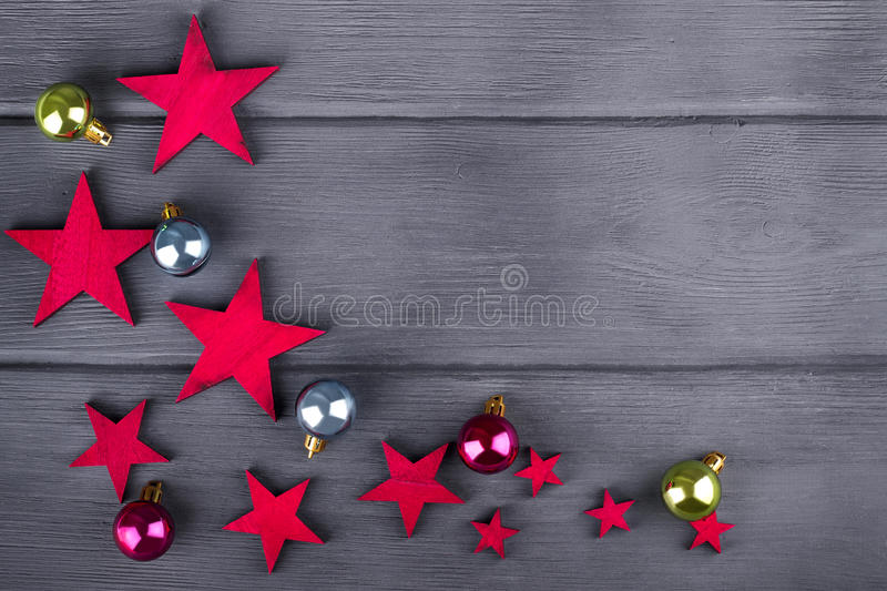 Christmas balls and stars on dark wooden background. Christmas balls and stars on wooden background stock images