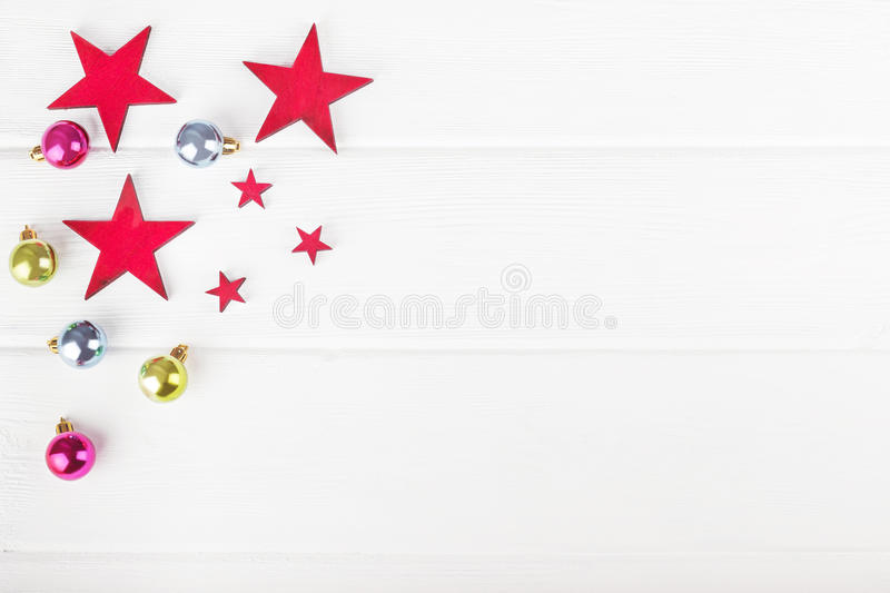 Christmas balls and stars on wooden background. Christmas balls and stars on white wooden background stock images