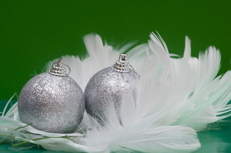 Christmas Balls On White Feather Royalty Free Stock Photography