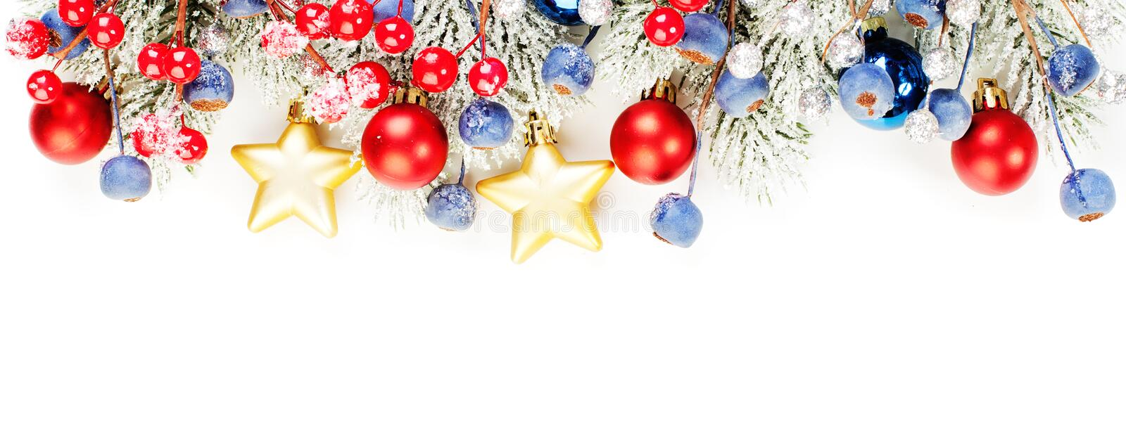 Christmas banner background. Xmas border composition with Christmas tree branch, red holly berries and gold garland isolated. On white background stock photo