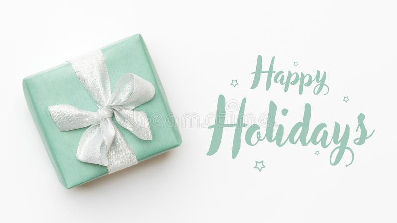 Christmas banner. Beautiful christmas gift isolated on white background. Turquoise colored wrapped xmas box. Gift wrapping. stock photos