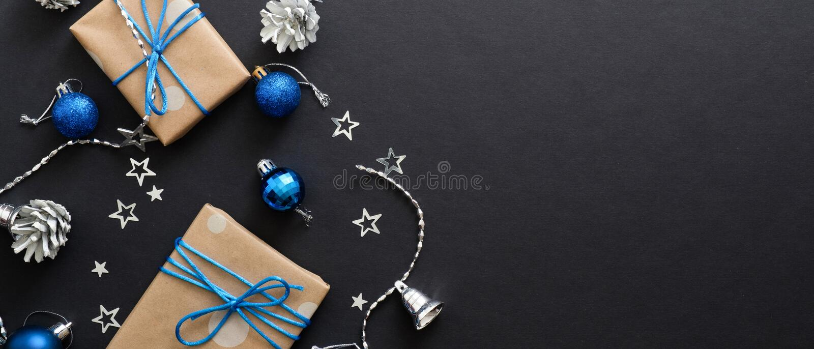 Christmas banner. Black Xmas background blue and silver bright decorations, gifts box, balls. Christmas postcard, greeting card stock photos