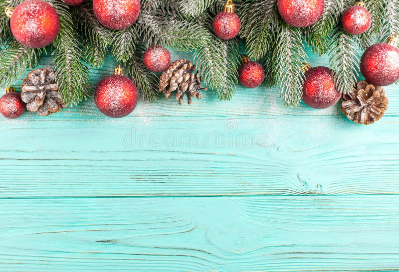 Christmas banner with green tree, red and white handmade felt decorations on white wooden textured background stock photography
