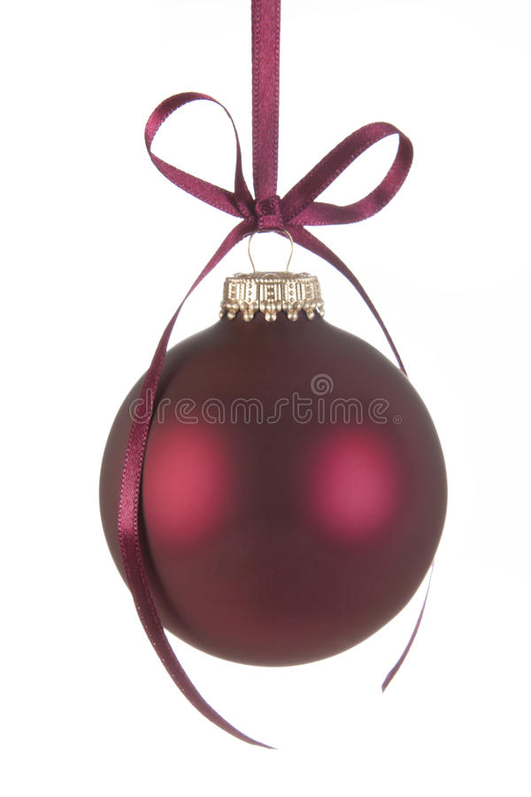 Christmas Bauble with bow. Hanging Red Christmas Bauble with a bow royalty free stock photo