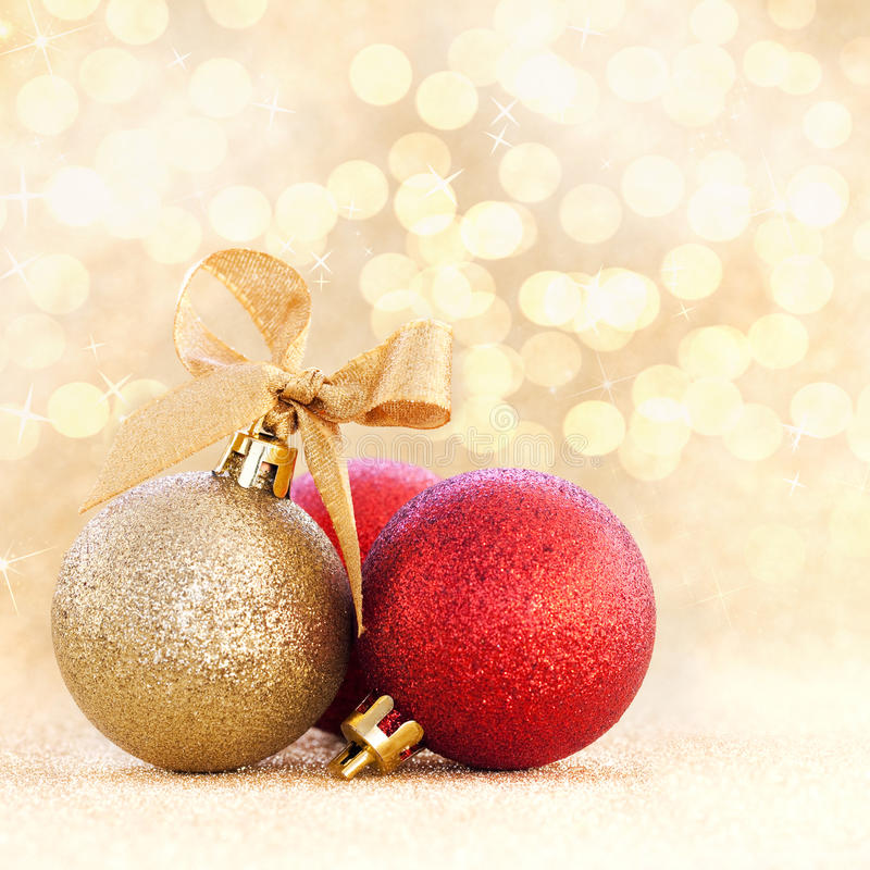 Christmas bauble on golden background stock photography