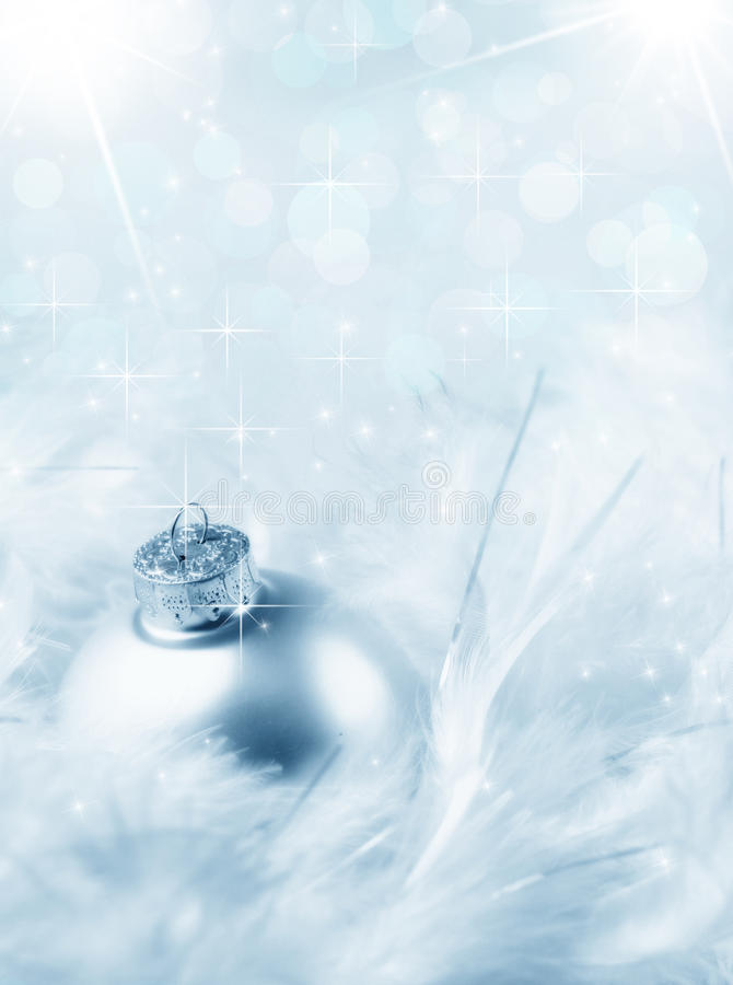 Christmas bauble and sparkles stock photo
