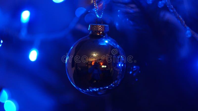A christmas bauble on the christmas tree stock photos