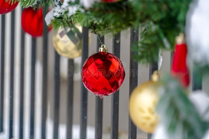 Christmas baubles and garland on a porch railing stock image