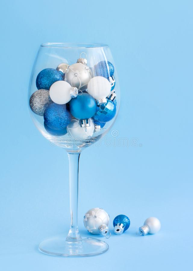 Free Christmas Baubles In A Wine Glass On A Light Blue Background Stock Image - 165391531