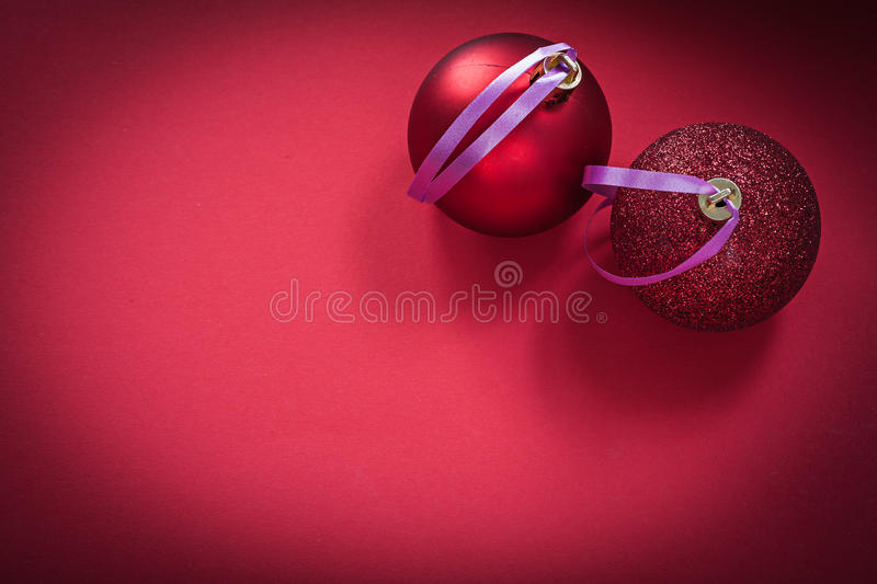 Christmas baubles red background holidays concept.  stock images