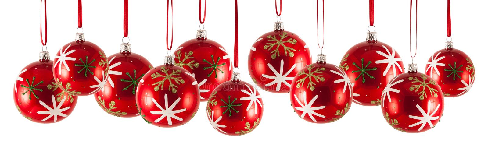 Christmas baubles in a row isolated on white background royalty free stock photos