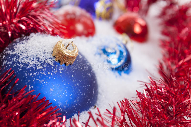 Christmas Baubles and snow royalty free stock photos
