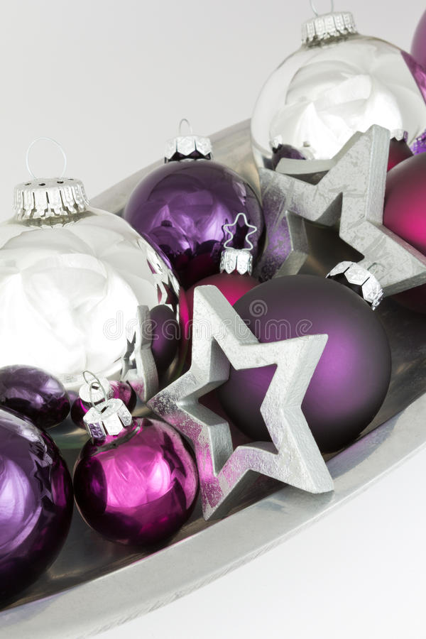 Christmas baubles stars silver violet royalty free stock photography
