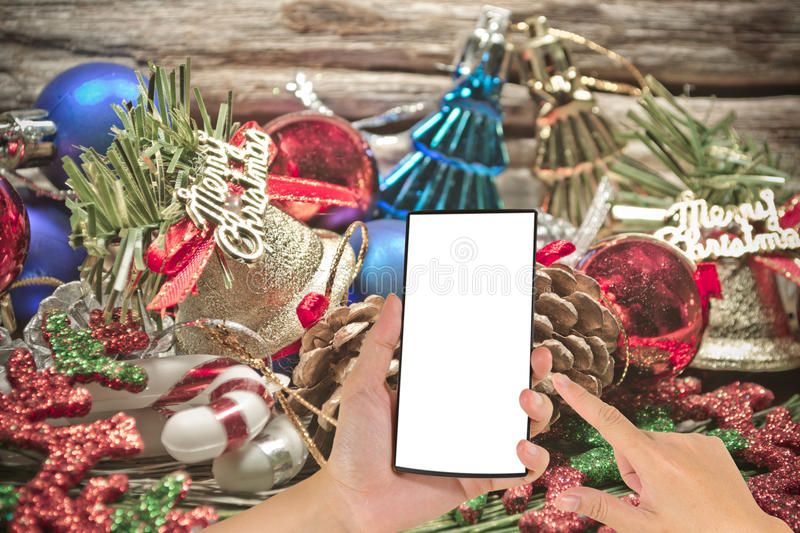 Christmas baubles and vary of decoration on wood background stock photo