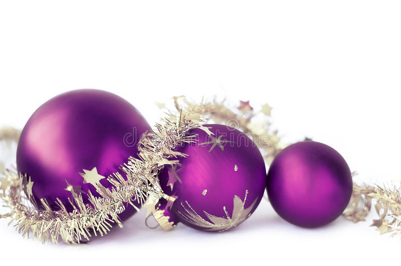 Christmas baubles on the white stock images