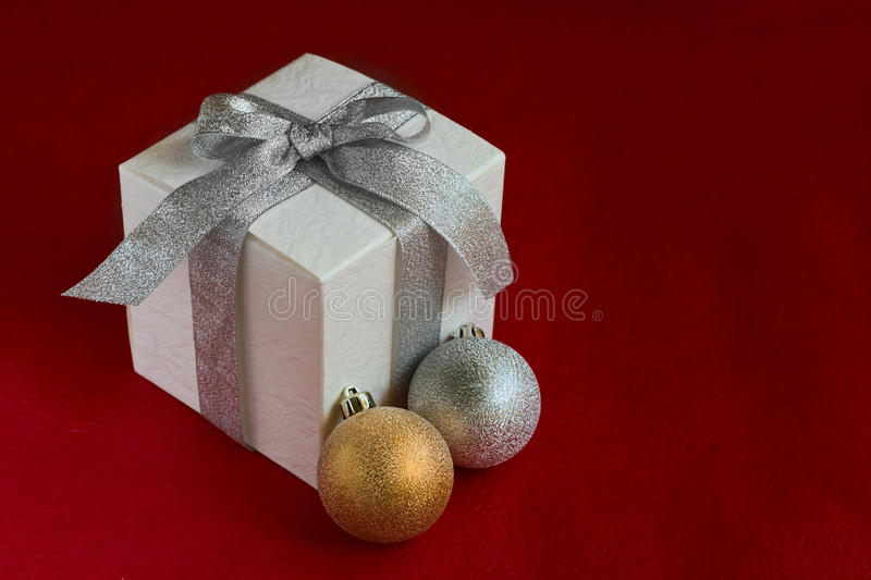 Christmas Baubles And White Gift Box Royalty Free Stock Images