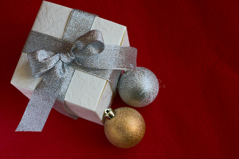 Christmas Baubles And White Gift Box Royalty Free Stock Photography