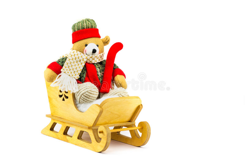 Christmas bear in wooden sleigh on white. Christmas bear in wooden sledge isolated on white background royalty free stock images